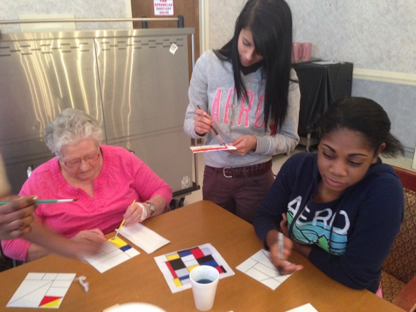 SLA senior Amneris Santiago and Junior Nakeyah Williams assist in art projects with residents at River Terrace Nursing Home.