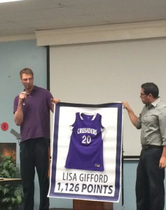 Mr. Cook presented Lisa Gifford her 1,000 point basketball banner.